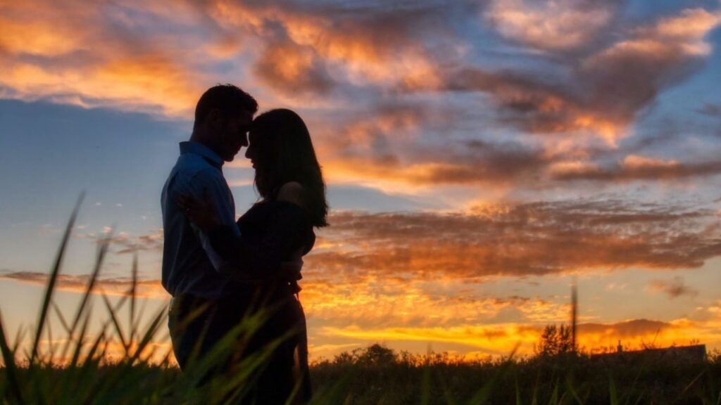 Couple in love silhouette with sunset